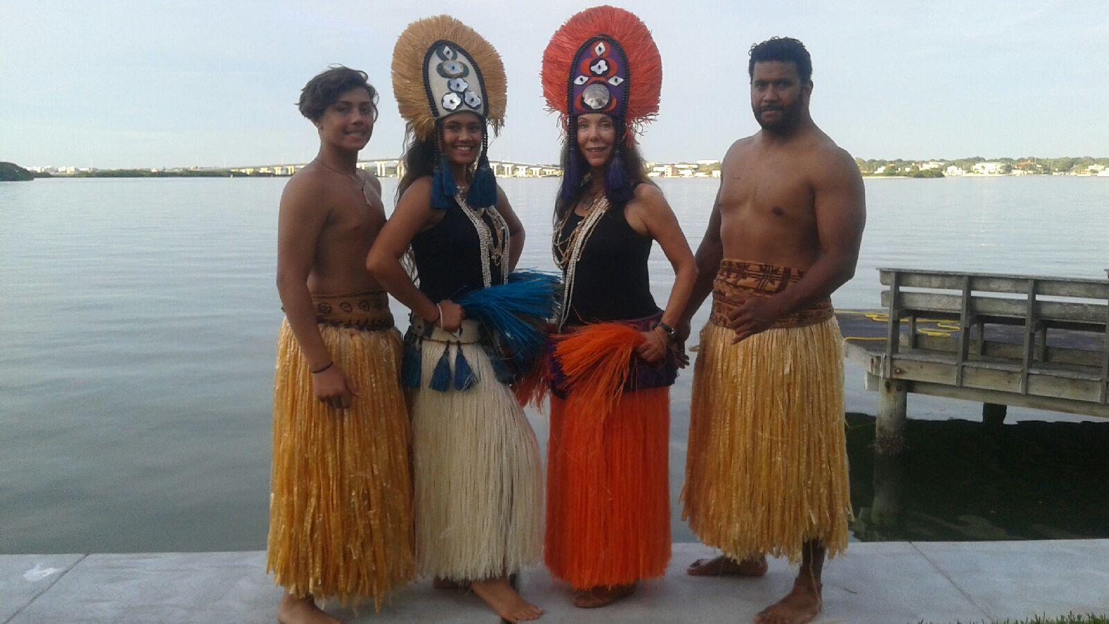 people representing a Hawaiian Luau
