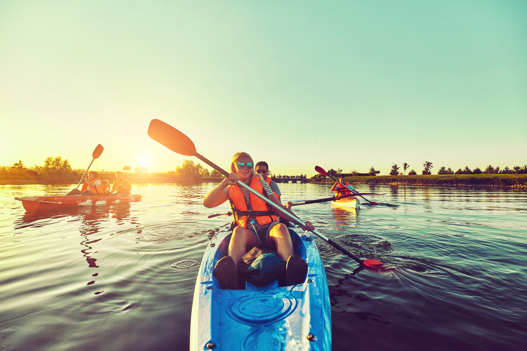 Kayaking and canoeing with family. Children on canoe. Family on kayak ride. This can be you if you join the kayak club.