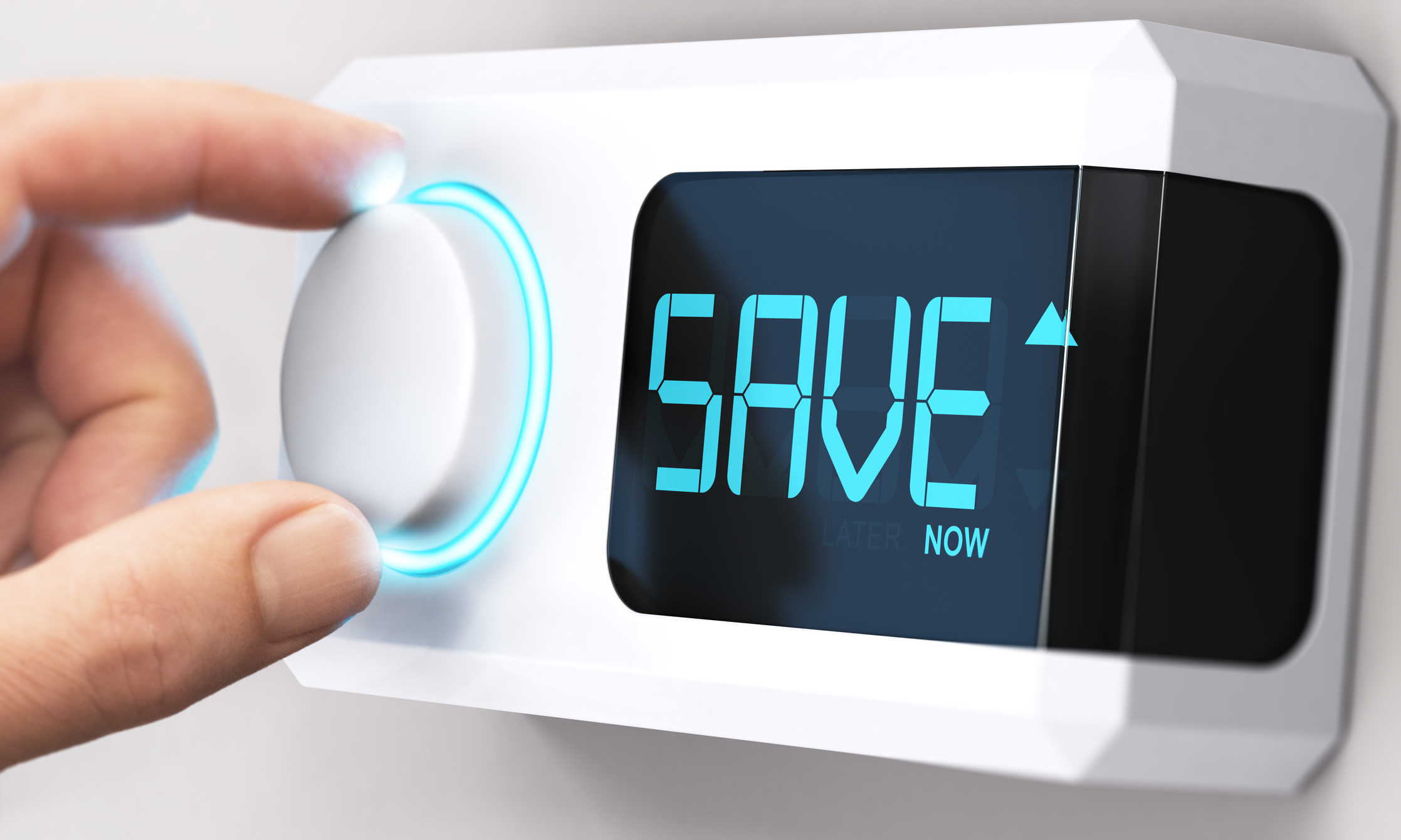 Hand turning a thermostat knob to increase savings by decreasing energy consumption. Composite image between a hand photography and a 3D background representing condos for sale in bradenton fl.